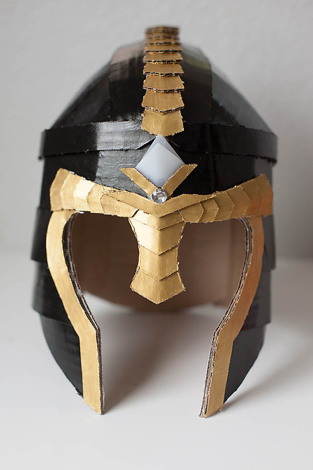 Crafteeo diy cardboard warrior helmets all for the boys for Cardboard armour template