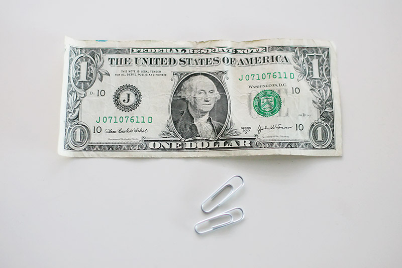 The Dollar Bill Paperclip Trick — All for the Boys: http://www.allfortheboys.com/home/2011/11/8/the-dollar-bill-paperclip-trick.html